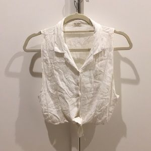 White collared button down top with tie